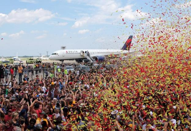 Cleveland Cavaliers fans celebrate as the team arrives home in Cleveland