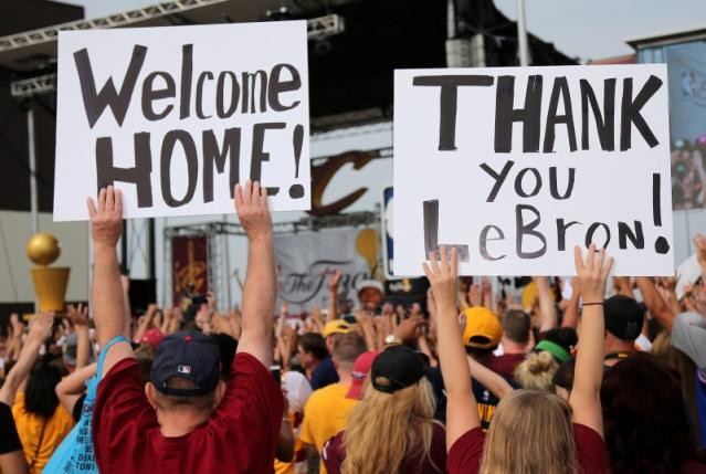 Cleveland Cavaliers fans celebrate and show their appreciation for LeBron James at a welcome party held at the airport in Cleveland