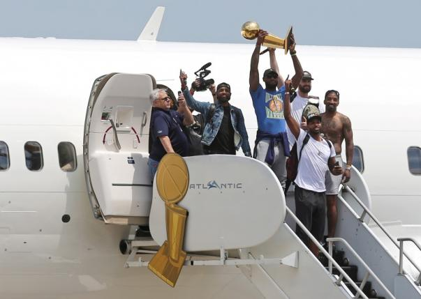 Cleveland Cavaliers Kyrie Irving, LeBron James, Kevin Love, JR Smith and Tristan Thompson arrive home to a welcome party in Cleveland