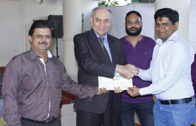 Ubaid Awan receiving certificate